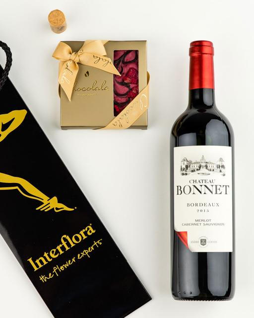 Gift bag with Chateau Bonnet red wine and dark chocolate raspberry bar
