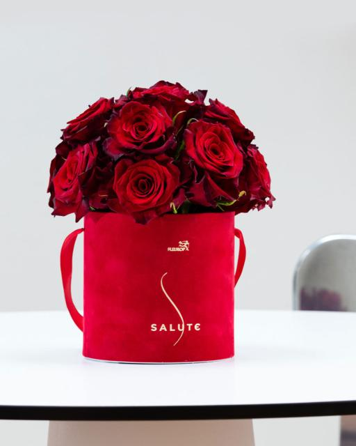 Embraced by roses in a red velvet box